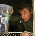 A. Whitman Miller of the Smithsonian Environmental Research Center checks an experimental aquarium used to rear juvenile oysters. (Smithsonian Environmental Research Center)